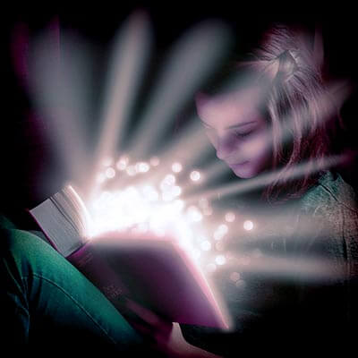 girl reading light in book