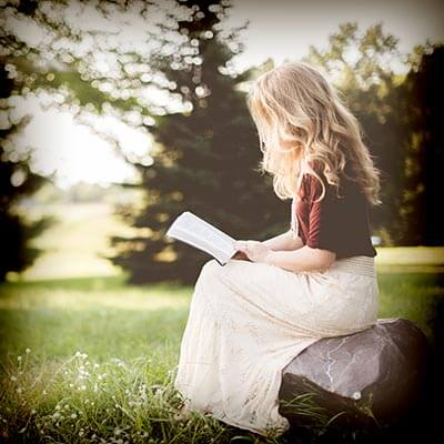 girl reading in field